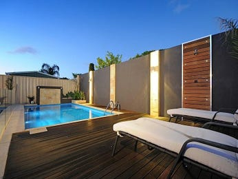 Landscaped pool design using tiles with pool fence & ground lighting - Pool photo 513859