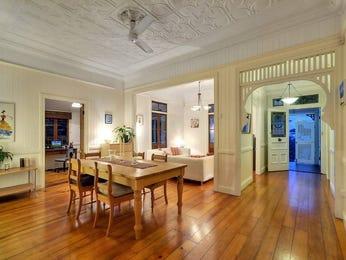 Casual dining room idea with hardwood & bi-fold doors - Dining Room Photo 338828