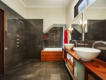 Modern bathroom design with twin basins using slate - Bathroom Photo 8622493