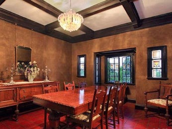 Classic dining room idea with floorboards & exposed eaves - Dining Room Photo 7040425