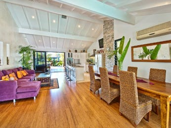 Modern dining room idea with floorboards & exposed eaves - Dining Room Photo 2141885