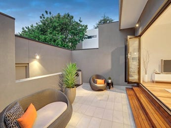 Indoor-outdoor outdoor living design with retaining wall & outdoor furniture setting using tiles - Outdoor Living Photo 7951549
