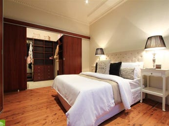 Classic bedroom design idea with floorboards & built-in wardrobe using beige colours - Bedroom photo 175820