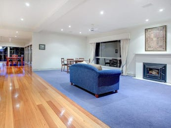 Open plan living room using blue colours with carpet & fireplace - Living Area photo 176105