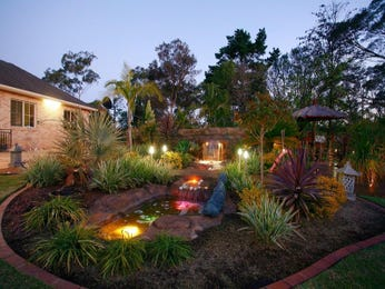 Landscaped garden design using brick with fish pond & decorative lighting - Gardens photo 176133