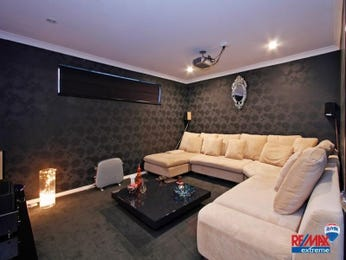 Open plan living room using black colours with carpet & fireplace - Living Area photo 177217