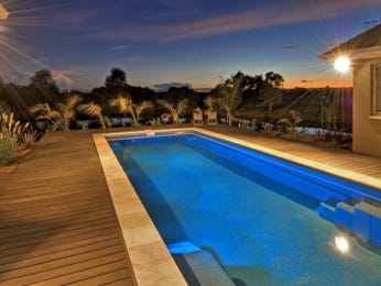 Endless pool design using bluestone with verandah & decorative lighting - Pool photo 177619