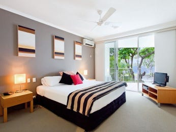 Modern bedroom ideas with feature wall in neutral for Bedroom designs with balcony