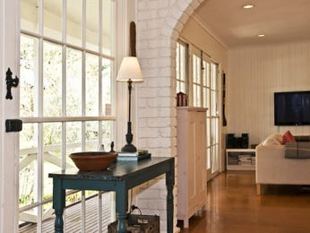 Retro dining room idea with exposed brick & floor-to-ceiling windows - Dining Room Photo 8628405