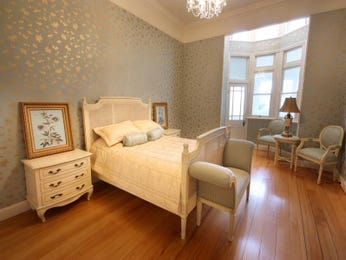 Classic bedroom design idea with floorboards & sash windows using cream colours - Bedroom photo 179475