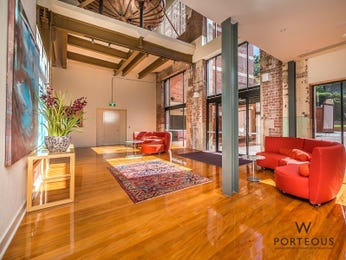 Open plan living room using red colours with exposed brick & exposed eaves - Living Area photo 15210221