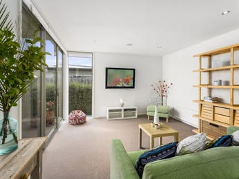 Green living room idea from a real Australian home - Living Area photo 17022461