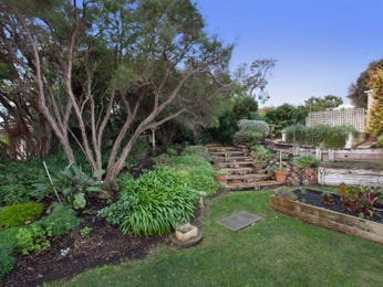 Landscaped garden design using grass with bbq area & rockery - Gardens photo 180459