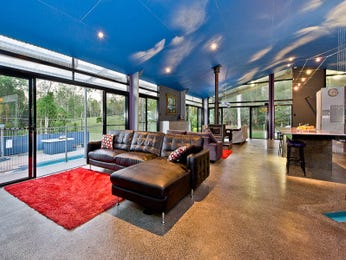 Open plan living room using blue colours with leather & floor-to-ceiling windows - Living Area photo 7090501