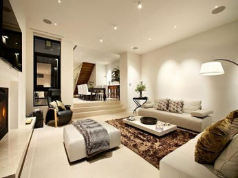 Dining-living living room using black colours with carpet & staircase - Living Area photo 181122