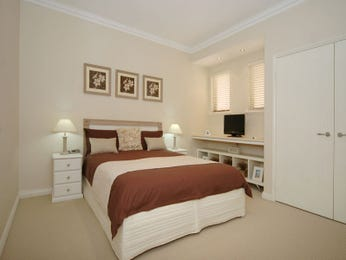 Classic bedroom design idea with hardwood & built-in desk using beige colours - Bedroom photo 181127