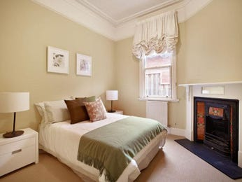 Romantic bedroom design idea with carpet & fireplace using beige colours - Bedroom photo 181870