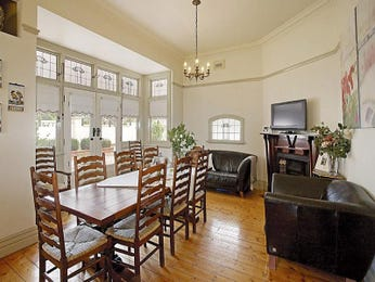 Formal dining room idea with bluestone & louvre windows - Dining Room Photo 348522