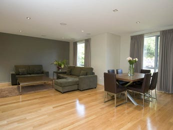 Dining-living living room using brown colours with floorboards & floor-to-ceiling windows - Living Area photo 433852
