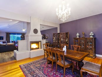 Classic dining room idea with floorboards & fireplace - Dining Room Photo 2252577