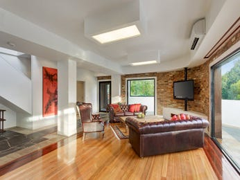 Split-level living room using brown colours with exposed brick & floor-to-ceiling windows - Living Area photo 15361633