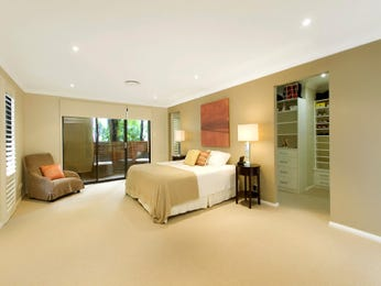 Modern bedroom design idea with carpet & built-in shelving using beige colours - Bedroom photo 231779