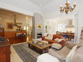 Open plan living room using brown colours with suede & fireplace - Living Area photo 475373