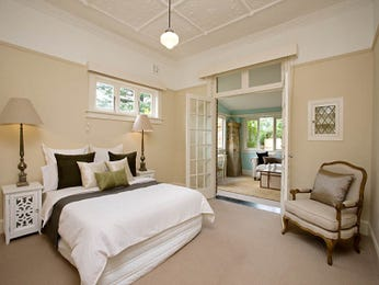 Modern bedroom design idea with carpet & bi-fold doors using cream colours - Bedroom photo 340704