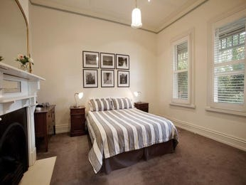 Modern bedroom design idea with carpet & fireplace using brown colours - Bedroom photo 233242
