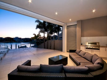 Enclosed outdoor living design with bbq area & outdoor furniture setting using tiles - Outdoor Living Photo 15115685