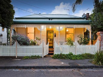 Corrugated iron edwardian house exterior with picket fence & decorative lighting - House Facade photo 235584