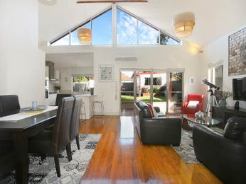 Dining-living living room using black colours with floorboards & floor-to-ceiling windows - Living Area photo 15631953