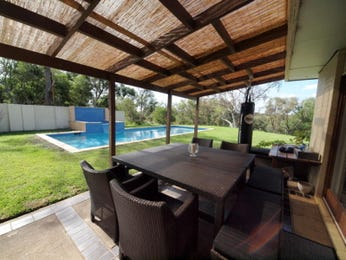 Multi-level outdoor living design with pool & latticework fence using grass - Outdoor Living Photo 454224