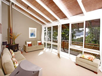 Open plan living room using cream colours with tiles & exposed eaves - Living Area photo 341006