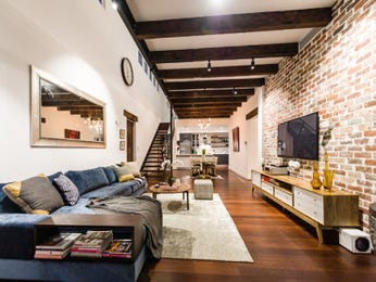 Open plan living room using beige colours with exposed brick & exposed eaves - Living Area photo 15173937