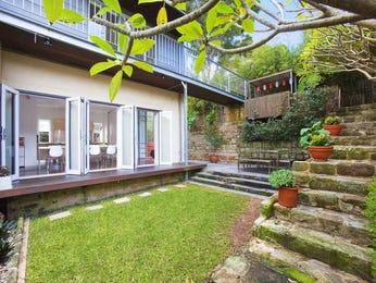 Landscaped garden design using grass with balcony & rockery - Gardens photo 238705