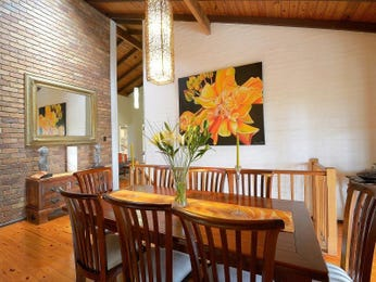 Classic dining room idea with exposed brick & exposed eaves - Dining Room Photo 7860749