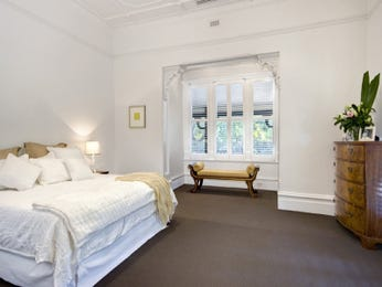 Classic bedroom design idea with carpet & window seat using brown colours - Bedroom photo 389590