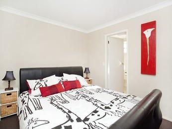 Retro bedroom design idea with floorboards & built-in desk using beige colours - Bedroom photo 446665