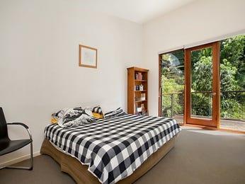 Classic bedroom design idea with carpet & bi-fold doors using black colours - Bedroom photo 1145140