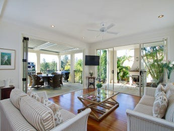 Open plan living room using white colours with hardwood & bay windows - Living Area photo 1570969