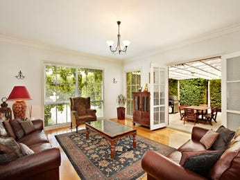 Split-level living room using beige colours with carpet & floor-to-ceiling windows - Living Area photo 700287
