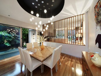 Modern dining room idea with floorboards & floor-to-ceiling windows - Dining Room Photo 15905137
