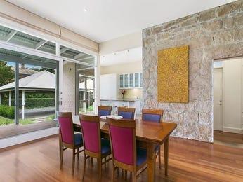 Retro dining room idea with hardwood & floor-to-ceiling windows - Dining Room Photo 7348837