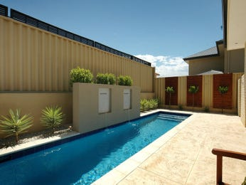 In-ground pool design using brick with pool fence & hedging - Pool photo 294855