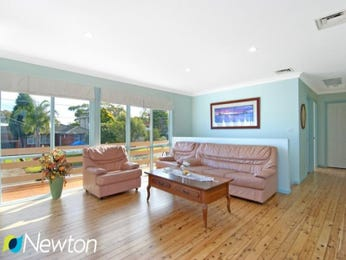 Split-level living room using brown colours with floorboards & floor-to-ceiling windows - Living Area photo 1468034