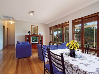 Open plan living room using blue colours with wood panelling & floor-to-ceiling windows - Living Area photo 840439