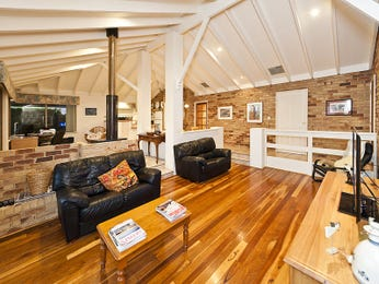 Open plan living room using grey colours with exposed brick & exposed eaves - Living Area photo 1143813