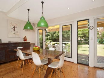 Retro dining room idea with wood panelling & french doors - Dining Room Photo 298161