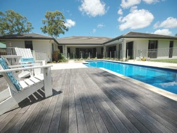 In-ground pool design using tiles with decking & outdoor furniture setting - Pool photo 298324
